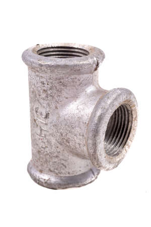 Metal hydraulic tee. A fitting used to connect water pipes. Light background.