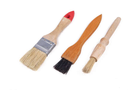 Three different brushes for work in the workshop. Accessories necessary for painting with paints. Light background. 스톡 콘텐츠