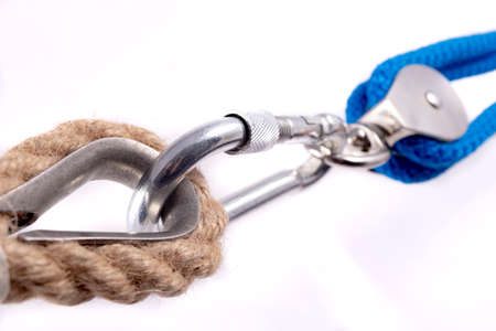 Carabiner, rope and sailing pulley. Accessories used on a deep sea yacht. Light background.
