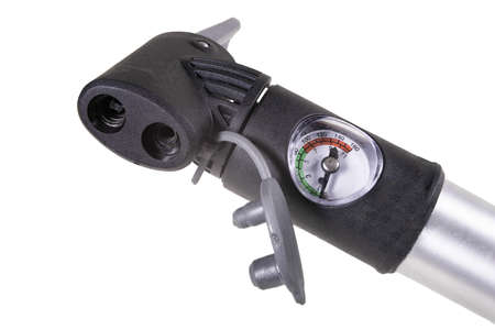Pump for inflating air in bicycle tires, equipped with a pressure gauge. Accessories for the servicing of the roer during a bike ride. Isolated background.