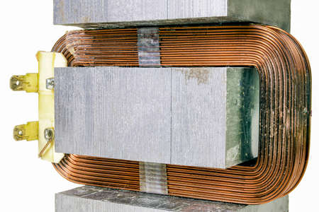 Copper winding used in the electromagnet. Device for changing the value of the magnetic field. Isolated background. Standard-Bild
