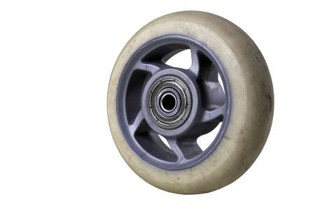 Worn out rubber wheel from roller skates. Spare parts for speed skates. Isolated background.