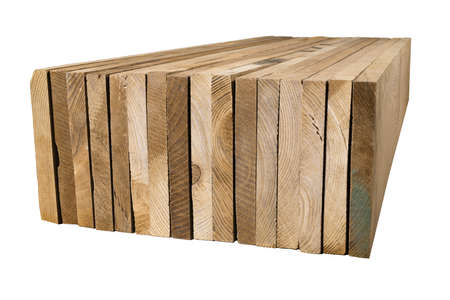 A pile of ash planks tinted dark in color. Stacked planed boards. Isolated background.