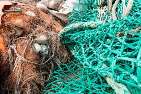 Mooring ropes and nets on a fishing boat. Accessories needed for fishing. Spring season.