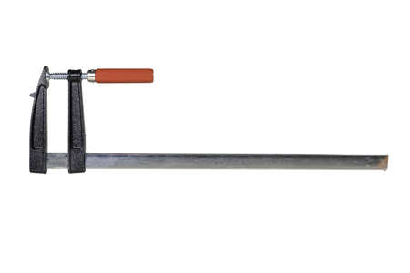 Carpenter's clamp used in a carpentry shop. Metal joinery accessories. Light background.