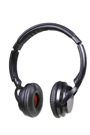 Black plastic headphones for listening to music. Accessories for fans of rock and classical music. Isolated background.
