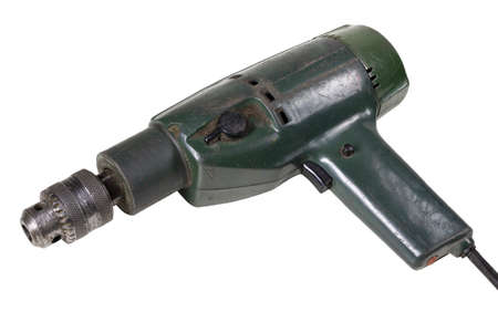 Old drill for making holes. Dirty and damaged tools for mechanics. Isolated background.