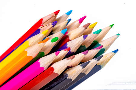 Pencils of different colors. Utensils used in school and kindergarten. Isolated background.