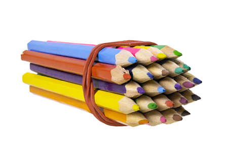 Tied colored pencil crayons. Accessories for drawing and drawing on paper. Isolated background.