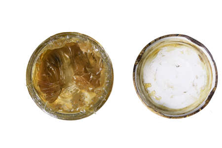 Machine grease in a glass jar. Material for lubricating machine parts used in the workshop. Isolated background. Reklamní fotografie