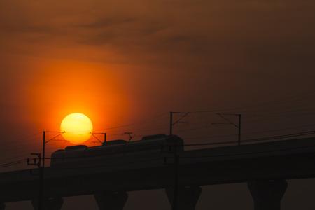 The electric train run pass the sun in twilight time  photo