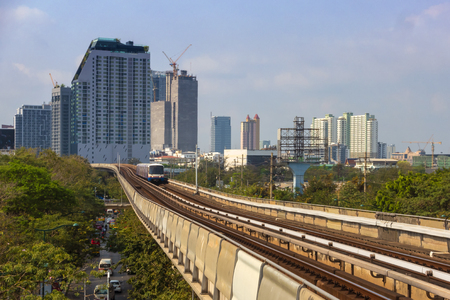 View of Bangkok, Thailand from BTS Skytrain to downtown with city landscape that full of buildings.