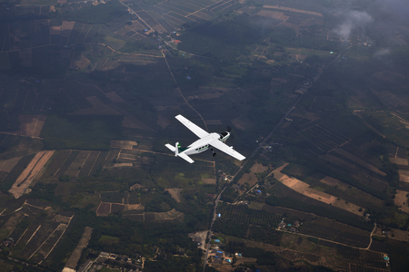An airplane fly over the framland for sight seeing. Stock Photo