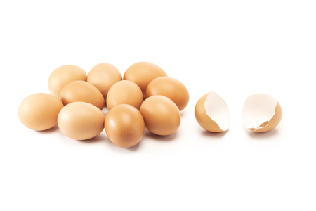 A cracked and open egg beside of other eggs isolated on white background Standard-Bild - 122421118