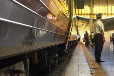 The Bangkok Hualamphong train station with the train staffs colour toned shallow focus