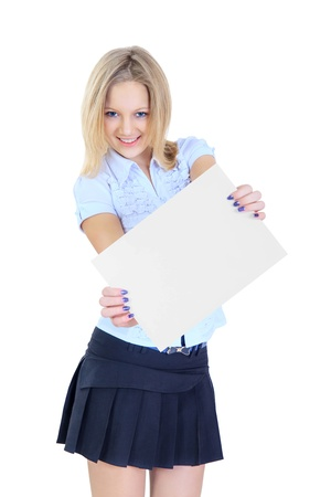Schoolgirl holding a white sheet of paper isolated on white background Stock Photo - 18286298