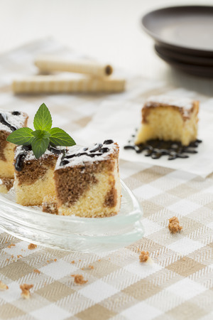 dessert topping: Black and White Cake with Wafer Rolls and Chocolate Topping