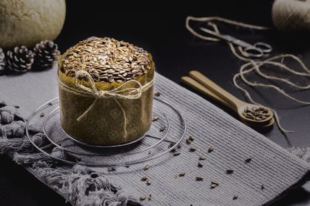 integral: Integral Bread with Sunflower on Black Table, Gray Cloth, Rope and Scissors
