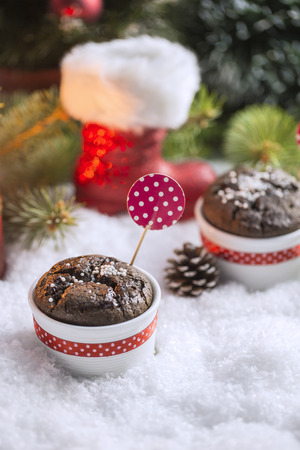 sweet background: Chocolate Cupcake with Snowflakes, Candle and Christmas Tree