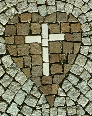 cross: Stone cross with a heart