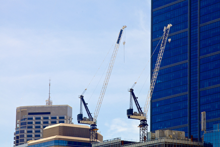 constraction: A crain on a new constraction site of high-rise building in Perth