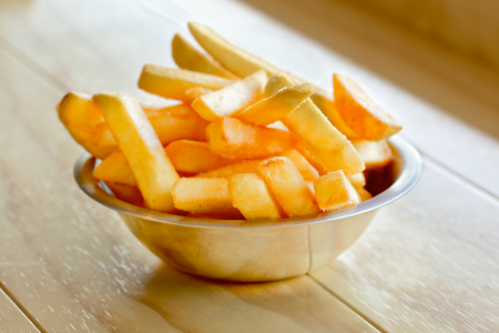 frites: Potatoes fries or chips on wooden board