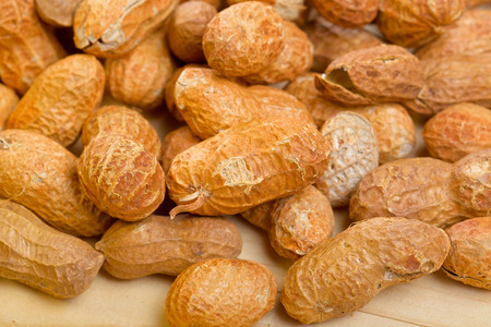 monkey nut: Peanuts in shelles on wooden table as a background