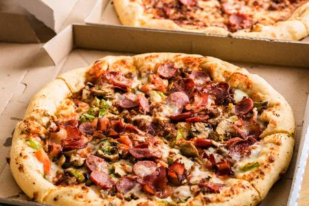 unsliced: Homemade pepperoni pizza in carton box Stock Photo