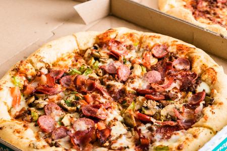 Homemade pepperoni pizza in carton box Stock Photo