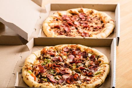 Homemade pepperoni pizza in carton boxes