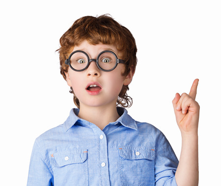 surprised kid: Portrait of handsome caucasian boy in round glasses who just has got an idea. Isolated on white background