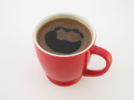 Perfect coffee in red coffee cup