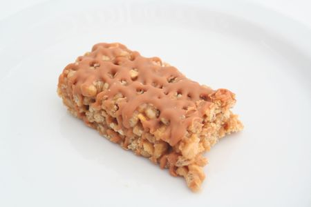 compressed rice: Half eaten snack bar on a white background
