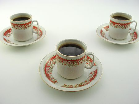 Three coffee cups on a white background