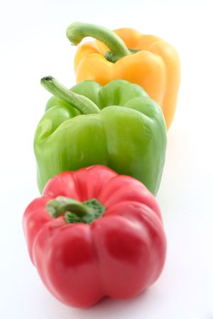 green yellow and red peppers on a white background Stok Fotoğraf