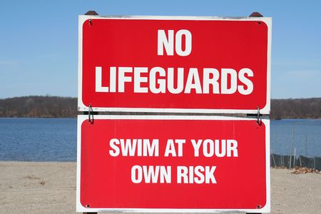 No lifeguards, swim at your own risk signs