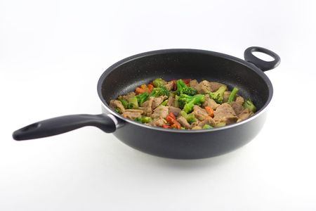 Stir fry in a pan Imagens
