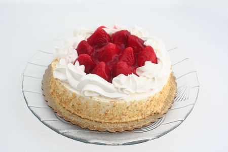 sinful: Strawberry cake on a white background