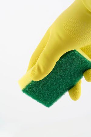 hand holding sponge on a white background Stock Photo