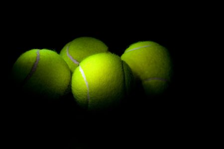 Tennis balls on a black background Stock Photo