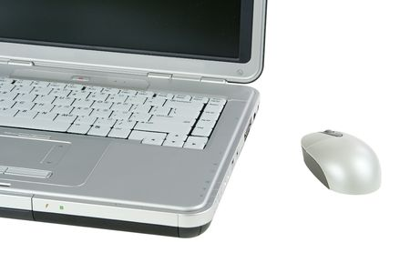 Laptop and a mouse isolated on a white background Banco de Imagens
