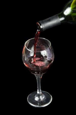 pouring wine in a glass on a black background Stock Photo - 716299