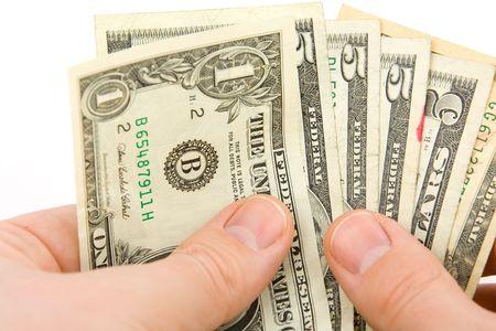 egoista: Contando dinero cerca aislados sobre fondo blanco  Foto de archivo