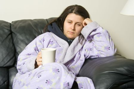 woman with a cold holding a cup with a hot tea 스톡 콘텐츠