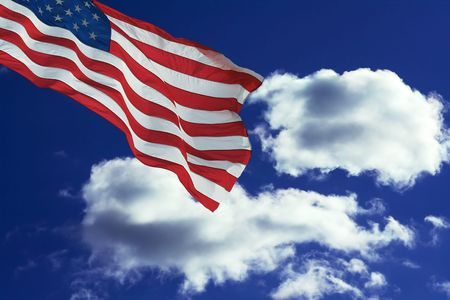 flag against blue sky with dramatic white clouds Stok Fotoğraf - 826765