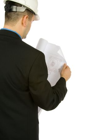 engineer inspecting a drawing isolated on a white background Stock Photo