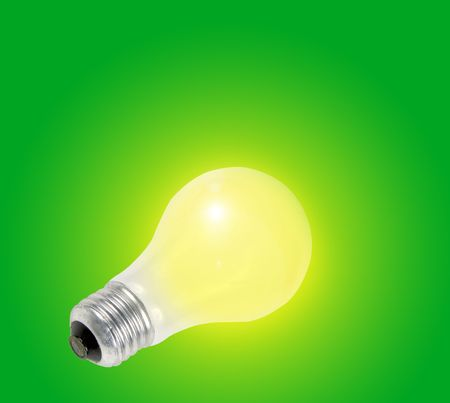 yellow light bulb with green background