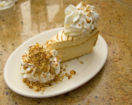 delicious caramel cheesecake with whipped cream