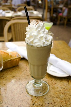 cocktail with whipped cream and irish coffee  photo