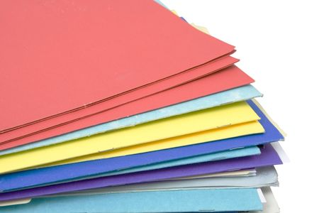 test deadline: stack of colorful file folders isolated against white background Stock Photo